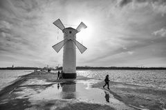 Beacon windmill Stawa Mlyny, town landmark against the sun. Royalty Free Stock Image
