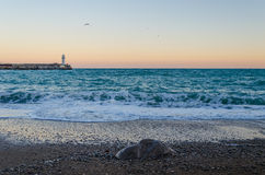 Beacon in Yalta at sunrise, a view from the central city embankment, Crimea Royalty Free Stock Photos