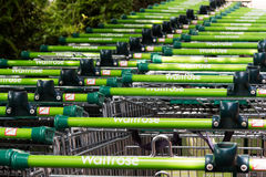 BEACONSFIELD, ENGLAND - JUNE 2016: Waitrose shopping trollies ou. Tside store in Beaconsfield Stock Images