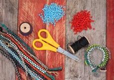 Bead bracelets making background Stock Photos