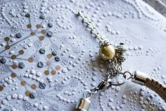 Bead charm on a light background royalty free stock photo