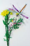Bead composition. With flowers and the dragonfly royalty free stock image