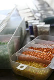 Bead Containers. Containers of seed beads, glass beads and other variations for crafting and jewelry making Royalty Free Stock Photos