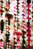 Bead curtains in Moroccan style. String of handmade bead curtains in Moroccan style have lighting effect stock photo