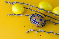 Bead easter egg and pussy-willow. Bead easter egg and sprigs of pussy-willow on a yellow background Stock Image