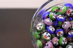 Bead-Filled Glass. Glass beads in a glass Stock Photography