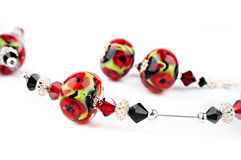 Bead handcrafted with poppies Stock Image