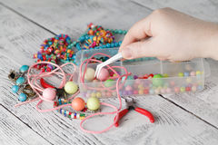 Bead making accessories. On white wooden table royalty free stock photo