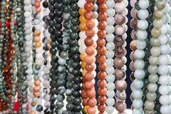 Bead necklaces on display in a bead shop stock photo