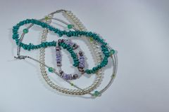 Bead necklaces and pearls. Vintage and modern necklaces and bracelets on a white background Stock Photo