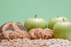 Bead, oat cereals and green apples Stock Photos