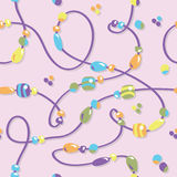 Bead Pattern. Beads on a string in a repeating seamless tile-able pattern Royalty Free Stock Photo