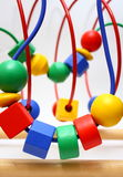 Bead Roller Coaster Toys. A child's bead roller coaster toy in primary colors royalty free stock photo