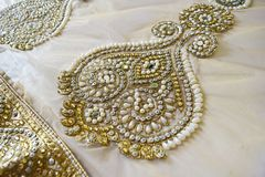 Bead work on fabric. Heavily embroidered designer bead work on Indian net saree stock image