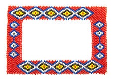Beaded African picture frame isolated on white. Picture frame decorated with African beads stock image