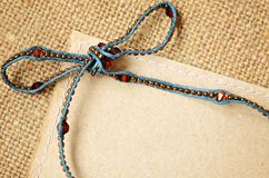 Beaded bow with card Stock Photography