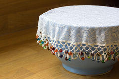 Beaded Bowl Cover. Lace and beaded food protector for a bowl stock photography