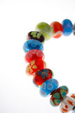 Beaded bracelet. Pretty bracelet of colorful glass beads on a white background Stock Photo