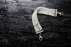 Beaded Bracelet. On Wooden Background stock images
