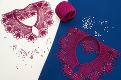 Beaded collars, knitted from red wool thread Stock Photography