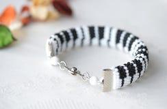 Beaded crochet bracelet like piano keyboard Royalty Free Stock Photo