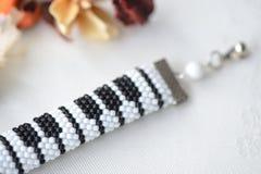 Beaded crochet bracelet like piano keyboard Royalty Free Stock Photos