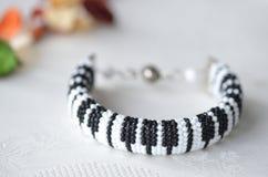 Beaded crochet bracelet like piano keyboard Royalty Free Stock Images