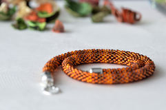 Beaded Crochet Necklace from amber color beads. Close up royalty free stock photography