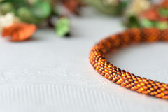 Beaded Crochet Necklace from amber color beads. Close up stock photos