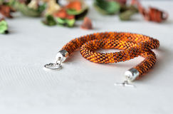 Beaded Crochet Necklace from amber color beads. Close up royalty free stock photo
