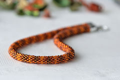 Beaded Crochet Necklace from amber color beads. Close up stock images