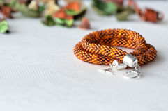 Beaded Crochet Necklace from amber color beads. Close up stock photography