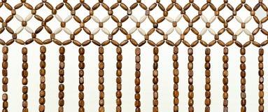 Beaded curtain. Wood bead curtain closeup Royalty Free Stock Photography