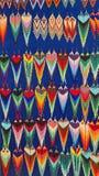 Beaded earrings. Hanging in a velvet display case in the Artisan`s Market in Otavalo, Ecuador stock photos
