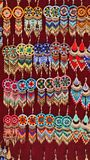 Beaded earrings. Hanging in a velvet display case in the Artisan`s Market in Otavalo, Ecuador royalty free stock images