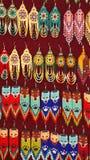 Beaded earrings. Hanging in a velvet display case in the Artisan`s Market in Otavalo, Ecuador royalty free stock image