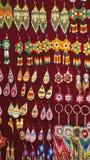 Beaded earrings. Hanging in a velvet display case in the Artisan`s Market in Otavalo, Ecuador stock images