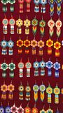 Beaded earrings. Hanging in a velvet display case in the Artisan`s Market in Otavalo, Ecuador royalty free stock photography