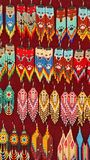 Beaded earrings. Hanging in a velvet display case in the Artisan`s Market in Otavalo, Ecuador stock image