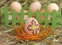 Beaded Easter egg on hay background Royalty Free Stock Image