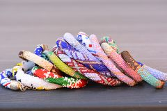 Beaded fashion Bracelets on a deck Stock Images