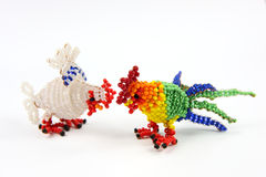 Beaded fowls. Color beaded and hen on white background stock photography