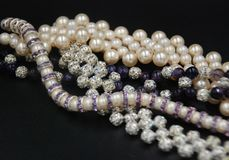 Beaded jewellery of pearls and crystals royalty free stock photos