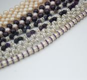 Beaded jewellery of pearls and crystals stock photo