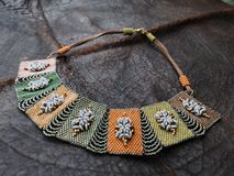 Beaded Ladies Neck Decorations. Personal ornaments, such as necklaces, rings, or bracelets, that are typically made from or contain jewels and precious metal stock photos