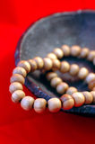 Beaded necklace. In a container against red background stock image