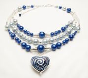 Beaded necklace with heart pendant Stock Photos