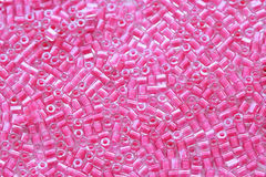 Beaded pink background. Small pink bead wallpaper Stock Image