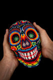 Beaded skull with hands - smiling death Royalty Free Stock Image