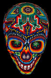 Beaded skull isolated on black. Colorful skull from mexican traditional huichol bead art, symbol of the day of the dead Stock Image